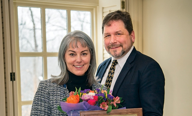 Beth Swanson receives her Connecting with Kids award from the Edina Community Foundation