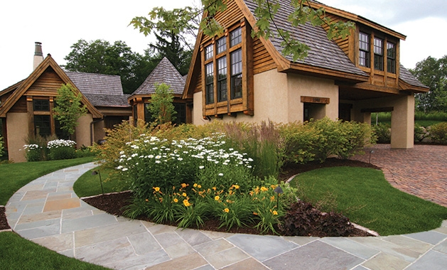 A yard with landscaping done by Yardscapes