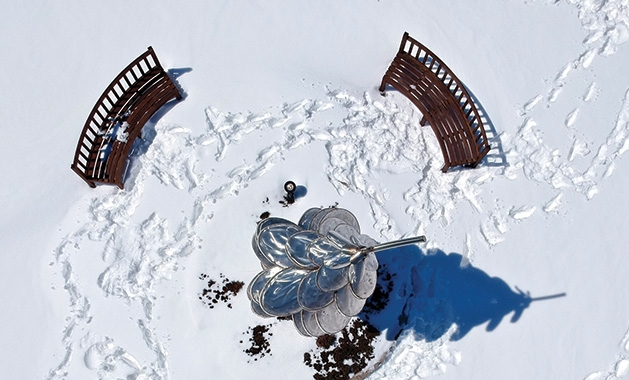 An overhead shot of a sculpture and benches in Centennial Lakes Park in Edina
