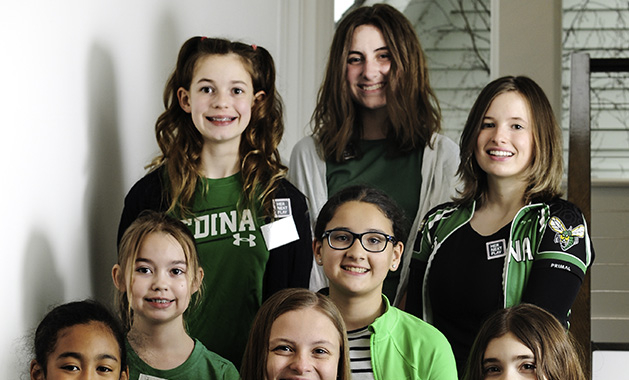 A group of female athletes from Edina poses at the Bold New Idea contest.