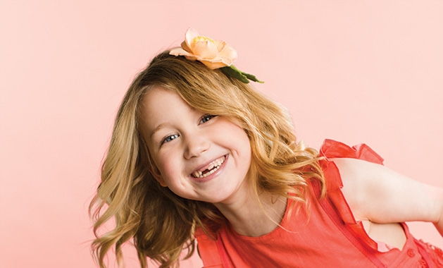 A young girl models Heartfelt Blooms' felt floral designs