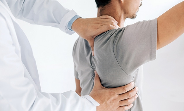 A chiropractor works on a patient's back at Chiropractic Health & Wellness