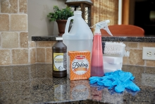 Cleaning products sit on a kitchen counter.
