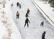 Skaters on the ice at Centennial Lakes Park.