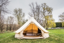 Pitch a glamping tent in your backyard.