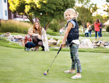 A child plays mini golf at Centennial Lakes Park
