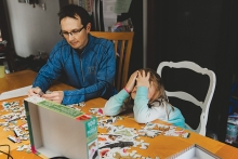 Dad and child distance learning