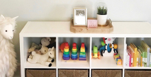 Children's toys sit organized on a set of shelves, thanks to Style + Dwell.