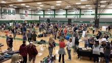 Families browse used gear at the Edina Give and Go gear swap.