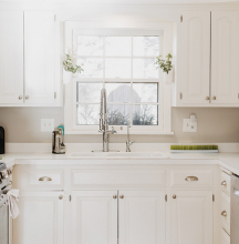 A white, clean kitchen.
