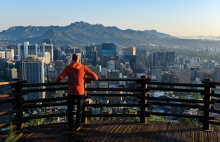 A high school student from an exchange program looks at the skyline in Seoul, South Korea.