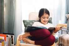 Young girl reading a picture book