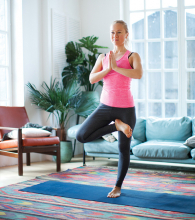 A woman poses while doing therapeutic yoga.