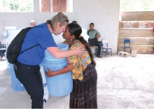 A Rotary Club of Edina member embraces a Guatemalan woman.