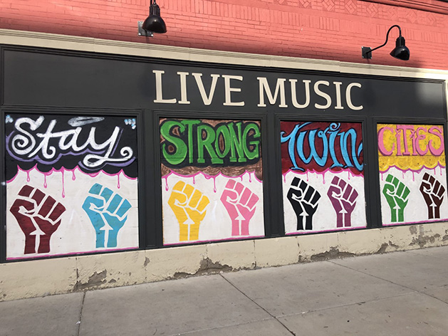 "A mural reading ""Stay Strong Twin Cities."""